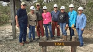 Volunteers clear Goose Island State Park nature trail after Hurricane Harvey