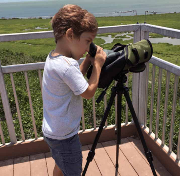 A future birder learns to use the scope