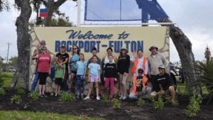 Mid-Coast Chapter members help Keep Aransas County Beautiful plant native plants at the city signs